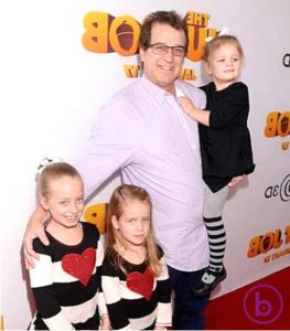 Allen Covert and his daughters